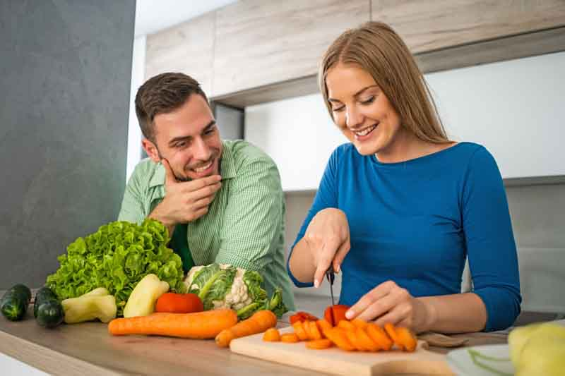 Couple making meal in their kitchen